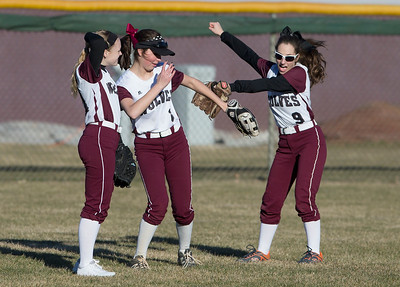 John Konstantaras - For the Northwest Herald Prairie Ridge outfielders Shannon Donaldson (11) (from left), Emelia Farnam (3) and Jillian Minutillo (9) dance to music as they wait for the inning to start during their game against Marian Central at Prairie Ridge High School  on Tuesday, March 21, 2017 Crystal Lake.