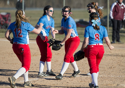 John Konstantaras - For the Northwest Herald Pitcher Maddie Peters (9) of Marian Central high fives her infielders after a strikeout during their game against Marian Central at Prairie Ridge High School  on Tuesday, March 21, 2017 Crystal Lake.