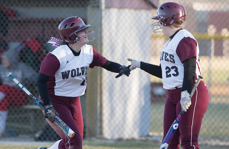 John Konstantaras - For the Northwest Herald Prairie Ridge's Kylie Leverenz (14) is greeted by Haley Barnes (23) as she scores on a hit by Kaleigh O'Brien during their game at Prairie Ridge High School  on Tuesday, March 21, 2017 Crystal Lake.
