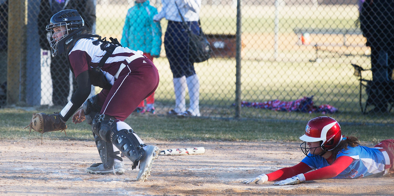 John Konstantaras - For the Northwest Herald Catcher Ashleigh Dierking (28) of Prairie Ridge field the ball as Emily Miller (4) of Marian Central scores during  their game at Prairie Ridge High School  on Tuesday, March 21, 2017 Crystal Lake.