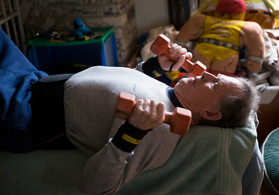 "John Konstantaras - For Shaw Media  ""Crazy Patrick"" Howden, 73, sets a record doing 5,800 reps with 8-pound weights in his home on Sunday, March 26, 23017 in Harvard."