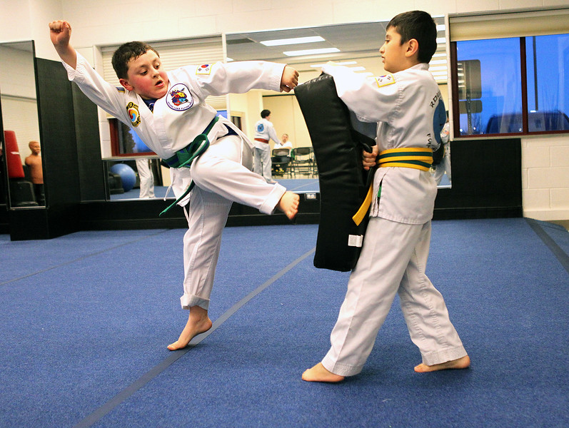Candace H. Johnson-For Shaw Media Elijah Karczewski, 7, of Round Lake Beach works on a step behind side thrust move with Eli Colins, 8, of Round Lake during a Round Lake Flying Dragons KiMudo class at the Round Lake Area Park District Sports Center in Round Lake Beach.