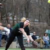 Glenbard West's Haley Walker throws out a runner during game one of a doubleheader against visiting Batavia on March 24. The Hilltoppers lost game one 7-2.