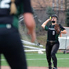 Glenbard West shortstop Eliza Pasterik throws out a runner during game one of a doubleheader against visiting Batavia on March 24. The Hilltoppers lost game one 7-2.