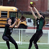 Glenbard West second baseman Katherine Porter steps in front of centerfielder Lexi Gregule to make the catch during game one of a doubleheader against visiting Batavia on March 24. The Hilltoppers lost game one 7-2.