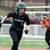Glenbard West's Angela Flammini heads for third base during game one of a doubleheader against visiting Batavia on March 24. The Hilltoppers lost game one 7-2.