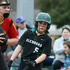 Glenbard West's Angela Flammini looks around the Batavia first baseman to see the pitch release during game one of a doubleheader in Glen Ellyn on March 24. The Hilltoppers lost game one 7-2.