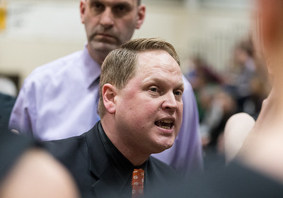 Whitney Rupp for Shaw Media Head coach of the Crystal Lake Central Tigers Rich Czeslawski directs his team during a timeout in the third quarter of the regional championship game Friday at Crystal Lake South.