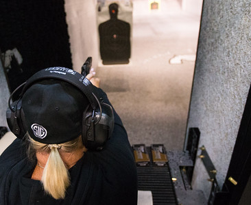 Whitney Rupp for Shaw Media Cathy Levin fires a handgun during a range rental session at Second Amendment Sports in McHenry Friday, March 2.