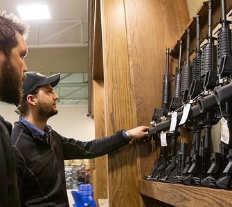 Whitney Rupp for Shaw Media Brothers Andy Popp, left, and Ben Popp, both of Crystal Lake, look at rifles on display at Second Amendment Sports in McHenry Friday, March 2.