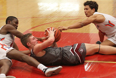 Candace H. Johnson-For Shaw Media Antioch's Branden Gallimore (center) battles for a loose ball with DePaul College Prep's Perry Cowan and Spencer Cody in the fourth quarter during the Class 3A sectional semifinals at North Chicago Community High School. DePaul College Prep won 51-28. (3/6/18)