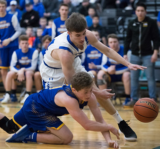 Whitney Rupp for Shaw Media Zach Schutta of Burlington Central fights to keep the ball inbounds alongside Johnsburg's Alec Smith Tuesday, March 6 in the Class 3A sectional semifinal game.