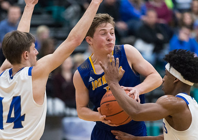 Whitney Rupp for Shaw Media Johnsburg's Alec Smith is surrounded by Burlington's Zach Schutta, left, and Dejsani Beamon during the fourth quarter of the Class 3A sectional semifinal Tuesday, March 6, at Woodstock North High School.