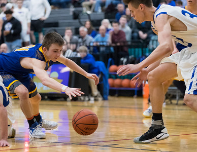 Whitney Rupp for Shaw Media Zach Toussaint of Johnsburg scrambles to keep the ball out of the hands of Burlington Central's William Hough in the fourth quarter of the Class 3A sectional semifinal Tuesday, March 6 at Woodstock North High School.