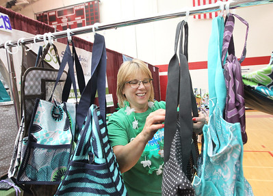 Candace H. Johnson-For Shaw Media Sheryl Dempsey, of Ingleside works on sorting through her Twenty-One totes she had for sale as a St. Baldrick's fundraiser during the Business & Craft Expo at Grant Community High School in Fox Lake. The event was sponsored by the Fox Lake Area Chamber of Commerce & Industry.(3/3/18)
