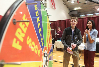 Candace H. Johnson-For Shaw Media Joe Gordon, of Ingleside and Ally Mahinay, of Lakemoor spin the wheel for a prize from Classic Cinemas Fox Lake during the Business & Craft Expo at Grant Community High School in Fox Lake. The event was sponsored by the Fox Lake Area Chamber of Commerce & Industry.(3/3/18)