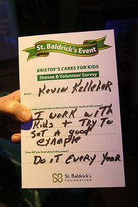 "Candace H. Johnson-For Shaw Media Kevin Kelleher, of Fox Lake shows the shavee survey he filled out before getting his head shaved during Kristof's Cares 4 Kids, ""Rock the Bald,"" St. Baldrick's fundraising event at Kristof's Entertainment Center in Round Lake Beach."
