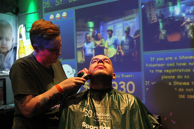"Candace H. Johnson-For Shaw Media Jessica Ross, of Spring Grove shaves off Bryan Rasmussen's, of Grayslake beard after his head was shaved during Kristof's Cares 4 Kids, ""Rock the Bald,"" St. Baldrick's event at Kristof's Entertainment Center in Round Lake Beach."