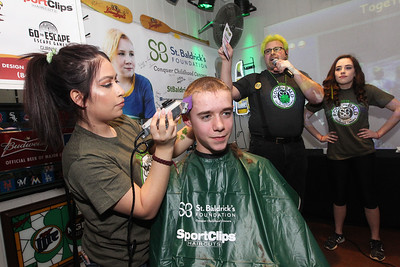 "Candace H. Johnson-For Shaw Media Michelle Herrera, of Algonquin shaves Darren Gorman's, 14, of Round Lake hair as Tom Welninski, of Antioch, the organizer of the event, talks to the crowd with his daughter, Anne, 18, of Lakemoor by his side during Kristof's Cares 4 Kids, ""Rock the Bald,"" St. Baldrick's event at Kristof's Entertainment Center in Round Lake Beach.Herrera volunteered at the event to cut people's hair and is a student at the Cosmetology & Spa Academy, of Crystal Lake.Anne Welninski is a childhood cancer survivor.Over the course of eight years at Kristof's the annual St. Baldrick's event has raised over $120,000. With this year's total they expect to raise an additional $15,000."