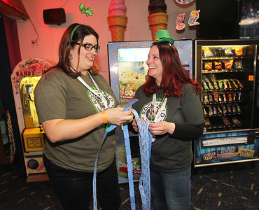 "Candace H. Johnson-For Shaw Media Erin Donovan, of Lake Villa and Christine August, of Lindenhurst separate raffle tickets during Kristof's Cares 4 Kids, ""Rock the Bald,"" St. Baldrick's fundraising event at Kristof's Entertainment Center in Round Lake Beach."
