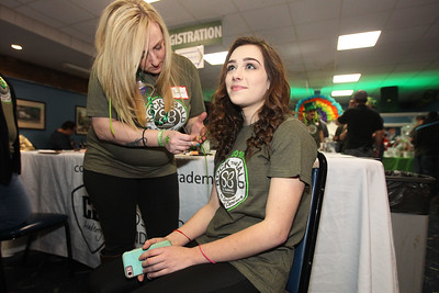 "Candace H. Johnson-For Shaw Media Amber Helmandollar, of Johnsburg puts a green extension in Anne Welninski's, 18, of Lakemoor hair during Kristof's Cares 4 Kids, ""Rock the Bald,"" St. Baldrick's event at Kristof's Entertainment Center in Round Lake Beach.Hellmandollar is a volunteer student from the Cosmetology & Spa Academy in Crystal Lake.Welninski is a pediatric cancer survivor."