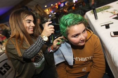 "Candace H. Johnson-For Shaw Media Perla Padilla, of Round Lake colors Jayden Jennings, 11, of McHenry hair green during Kristof's Cares 4 Kids, ""Rock the Bald,"" St. Baldrick's event at Kristof's Entertainment Center in Round Lake Beach.Padilla was a volunteer from the Cosmetology & Spa Academy, in Crystal Lake."