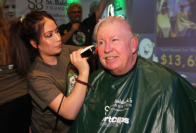 "Candace H. Johnson-For Shaw Media Michelle Herrera, of Algonquin shaves Kevin Kelleher's, of Fox Lake hair during Kristof's Cares 4 Kids, ""Rock the Bald,"" St. Baldrick's event at Kristof's Entertainment Center in Round Lake Beach.Herrera was a volunteer and student from the Cosmetology & Spa Academy in Crystal Lake."