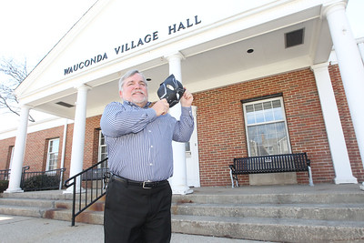 Candace H. Johnson-For Shaw Media Mayor Lincoln Knight holds a Black Panther mask in honor of the superhero film, which is based in the fictional country of Wakanda, outside the Wauconda Village Hall.