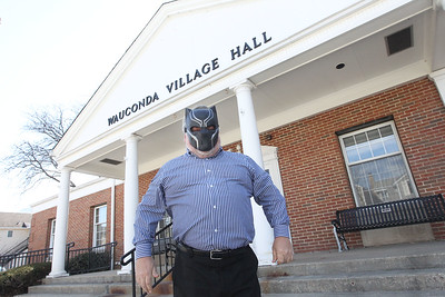 Candace H. Johnson-For Shaw Media Mayor Lincoln Knight wears a Black Panther movie mask to celebrate the superhero film, based in the fictional  nation of Wakanda, outside the Wauconda Village Hall in downtown Wauconda.