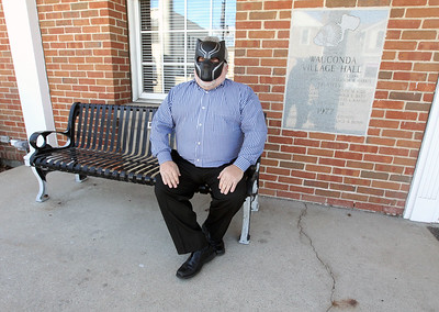 Candace H. Johnson-For Shaw Media Mayor Lincoln Knight has some fun wearing a Black Panther movie mask in honor of the superhero film, based in the fictional nation of Wakanda, as he sits outside of the Wauconda Village Hall.