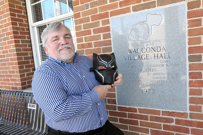 Candace H. Johnson-For Shaw Media Mayor Lincoln Knight holds a Black Panther mask in honor of the superhero film, which is based in the fictional nation of Wakanda, outside of the Wauconda Village Hall.