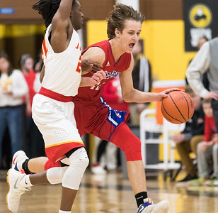 Whitney Rupp for Shaw Media Joshua Raby of Dundee-Crown drives against Jefferson's Quillin Dixon in the first quarter of Wednesday's Class 4A sectional semifinal.
