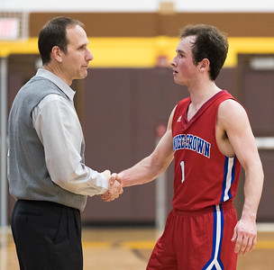 Whitney Rupp for Shaw Media Dundee-Crown senior Jack Orndhal meets head coach Lance Huber as he walks the court after his final game as a Charger Wednesday, March 7.