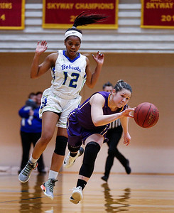 McKaylie Krey (3) from MCC grabs a turnover in front of Ashley Williams (12) from Bryant & Stratton College during their NJCAA Region IV game against Bryant and Stratton College at Waubonsee Community College on Saturday, March 10, 2018 in Sugar Grove , Illinois. The Scotts lost to the Bobcats in overtime 81-70. John Konstantaras photo for Shaw Media