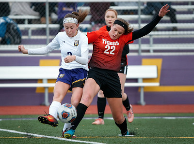 Emma Bowlanowski (22) from Crystal Lake Central fights for position on a ball with Sarah Rizzo (2) from Wauconda during the first half of their game at Wauconda High School on Monday, March 12, 2018 in Wauconda, Illinois. The Bulldogs defeated the Tigers 4-2. John Konstantaras photo for Shaw Media