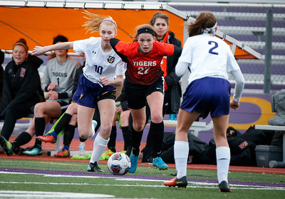 Emma Bowlanowski (22) from Crystal Lake Central chase a ball with Tara Bierdz (10) from Wauconda during the first half of their game at Wauconda High School on Monday, March 12, 2018 in Wauconda, Illinois. The Bulldogs defeated the Tigers 4-2. John Konstantaras photo for Shaw Media