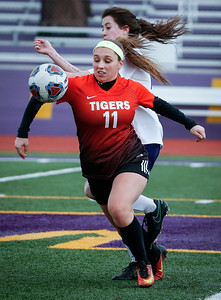 Madison Rokos (11) from Crystal Lake Central keeps the ball in front of Rachel DeNovo (13) from Wauconda during the first half of their game at Wauconda High School on Monday, March 12, 2018 in Wauconda, Illinois. The Bulldogs defeated the Tigers 4-2. John Konstantaras photo for Shaw Media