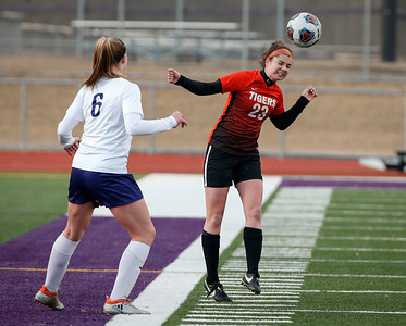 Abbey Kramer (23) from Crystal Lake Central heads a ball past Morgan Lung (6) from Wauconda during the second half of their game at Wauconda High School on Monday, March 12, 2018 in Wauconda, Illinois. The Bulldogs defeated the Tigers 4-2. John Konstantaras photo for Shaw Media