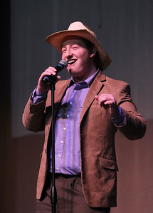 "Candace H. Johnson-For Shaw Media Jack Myers, 17, of Fox Lake sings ""She Taught Me To Yodel,"" during the finals of the Variety Show at Grant Community High School in Fox Lake. Myers came in first place."