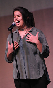 "Candace H. Johnson-For Shaw Media Madai Duran, 17, of Fox Lake sings, ""Seven Nation Army,"" in the finals during the Variety Show at Grant Community High School in Fox Lake."