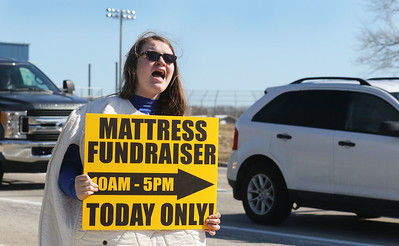 Candace H. Johnson-For Shaw Media Choir student Natasha Blachowski, 14, of Lindenhurst advertises the 5th annual Mattress Palooza Fundraiser at Lakes Community High School as she sings about the sale while holding a sign on Grass Lake Road in Lake Villa.Proceeds from the event will go towards the Fine Arts program and Friends of the Arts.(3/10/18)