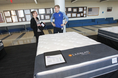 Candace H. Johnson-For Shaw Media Susan Dunat, of Barrington, owner of Custom Fundraising Solutions, talks with Elliott Hile, of Deerfield, assistant band director, about the Southerland bed he was buying during the 5th annual Mattress Palooza Fundraiser at Lakes Community High School in Lake Villa.Proceeds from the event go to the Fine Arts program and Friends of the Arts.(3/10/18)