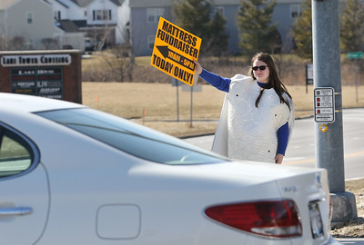 Candace H. Johnson-For Shaw Media Choir student Natasha Blachowski, 14, of Lindenhurst advertises the 5th annual Mattress Palooza Fundraiser at Lakes Community High School while holding a sign on Grass Lake Road in Lake Villa.Proceeds from the event will go towards the Fine Arts program and Friends of the Arts.(3/10/18)