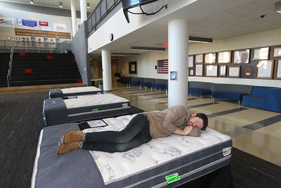 Candace H. Johnson-For Shaw Media Lakes Choir Director Daniel Ermel, of Wheeling, lays down on a bed he is considering buying during the 5th Annual Mattress Palooza Fundraiser at Lakes Community High School in Lake Villa.Proceeds from the event will go towards the Fine Arts program and Friends of the Arts.(3/10/18)