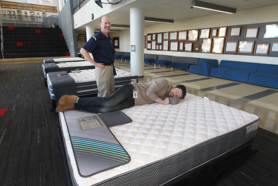 Candace H. Johnson-For Shaw Media Tom Vondrak, of Chicago Heights, a salesperson with Custom Fundraising Solutions, helps Daniel Ermel, of Wheeling, Lakes choir director, with picking out a mattress during the 5th Annual Mattress Palooza Fundraiser at Lakes Community High School in Lake Villa.Proceeds from the event will go towards the Fine Arts program and Friends of the Arts.(3/10/18)