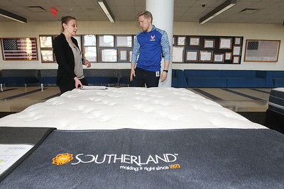 Candace H. Johnson-For Shaw Media Susan Dunat, of Barrington, owner of Custom Fundraising Solutions, talks with Elliott Hile, of Deerfield, assistant band director, about a Southerland bed he was buying during the 5th annual Mattress Palooza Fundraiser at Lakes Community High School in Lake Villa.Proceeds from the event go towards the Fine Arts program and Friends of the Arts.(3/10/18)