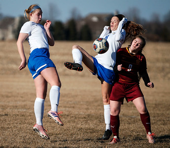 Melinda McBride (8) from Johnsburg fields a ball in front of Charlie Holas (9) from Richmond-Burton during the second half of their game at Johnsburg High School on Thursday, March 15, 2018 in Johnsburg, Illinois. The Rockets beat the Skyhawks 2-1. John Konstantaras photo for Shaw Media