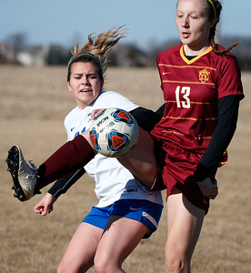 Leigh Denzel (13) from Richmond-Burton stops a ball in front of Alexis Connerty (21) from Johnsburg during the first half of their game at Johnsburg High School on Thursday, March 15, 2018 in Johnsburg, Illinois. The Rockets beat the Skyhawks 2-1. John Konstantaras photo for Shaw Media