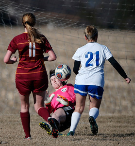 Alexis Connerty (21) from Johnsburg kicks the ball past goalie Lindsy Restis (1) from Richmond-Burton before scoring her goal during the first half of their game at Johnsburg High School on Thursday, March 15, 2018 in Johnsburg, Illinois. The Rockets beat the Skyhawks 2-1. John Konstantaras photo for Shaw Media