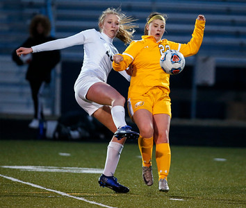 Tori Adams (22) from Jacobs stops a ball in front of Makenna Hughes (28) from Bartlett during the first half of their game at Millennium Field on Friday, March 16, 2018 in Streamwood, Illinois. John Konstantaras photo for Shaw Media